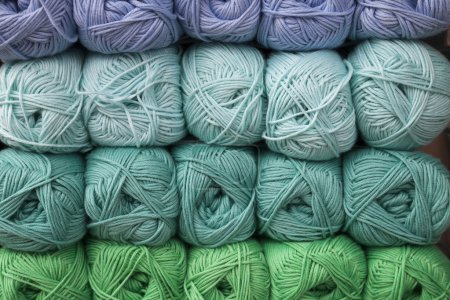 Stacked balls of colorful wools, abstract yarn bac...