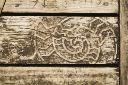 Photo for Detail of wooden bench with abstract woodcarving - Royalty Free Image