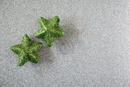 Photo for Green glossy stars on silver shiny background - Royalty Free Image
