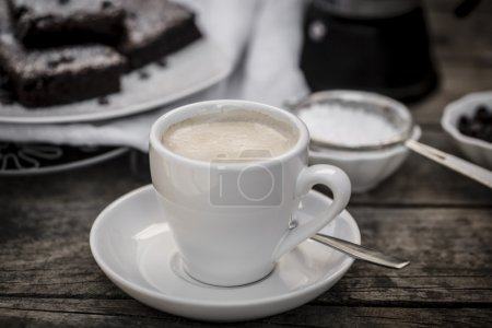 Cup of coffee with brownies