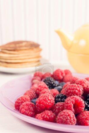 Fresh berries and homemade pancakes