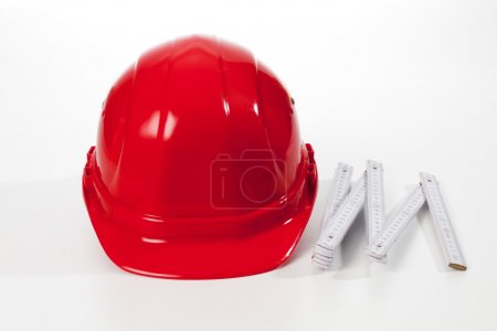 Red hardhat and folding ruler
