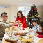 Chinese family enjoying their christmas dinner. Th...