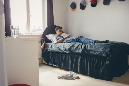 Teenager using Smartphone at Home