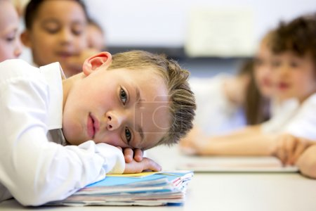 Photo for A close up shot of a little boy at school who looks distant and upset. - Royalty Free Image