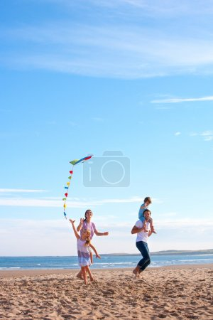 Family on Beach with Kite