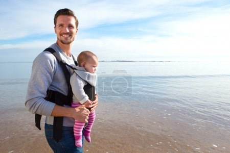 Father and Baby Daughter on Beach