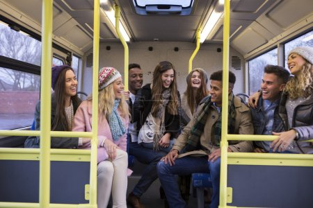 Young people travelling by bus together.