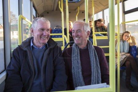Senior men on the bus