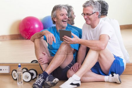 Men relaxing after gym workout
