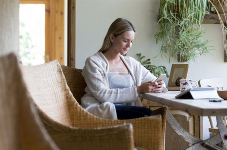 Woman using technology at home