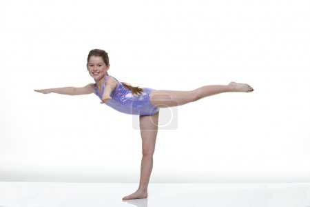 Portrait of a young female gymnast taken in the st...