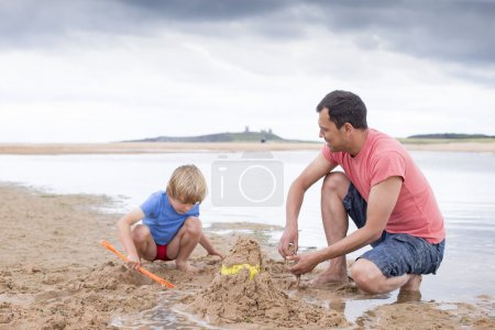 Playing on the beach with dad