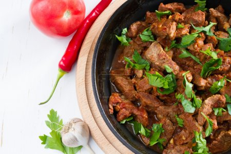 Photo for Chahohbili - traditional georgian beef stew in frying pan - Royalty Free Image