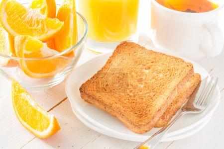 Photo for Breakfast on white wood background with toast with jam, orange, juice, tea - Royalty Free Image