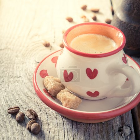 Coffee in white cup with hearts