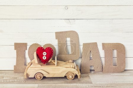 Fathers day background with wooden toy car and cardboard letters