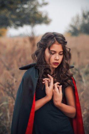 Vampire girl  Dracula in a raincoat