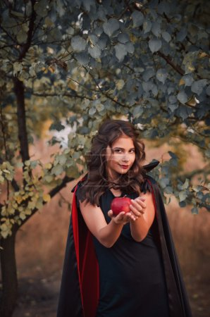 The girl-vamp, offers an apple