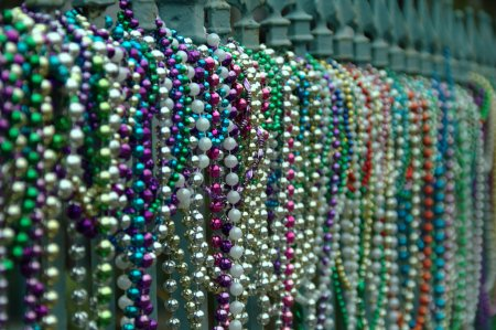 Beads aligned on fence in New Orleans in Lousiana after Mardi Gras