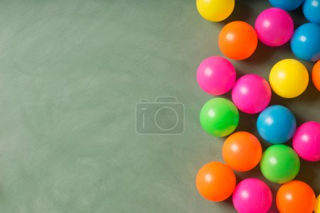 Green chalkboard and colorful balls