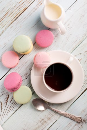 Photo for Cup of coffee and macaroons on the wooden table - Royalty Free Image