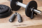 Weights and dumbbell set for fitness  on a wooden background