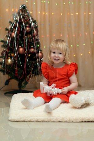 Happy little girl with christmas tree