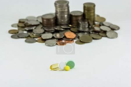 Medicine and money on white background. Expensive bill. Finance