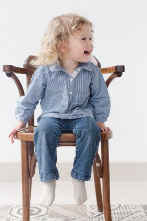 Two year old child sitting full body portrait
