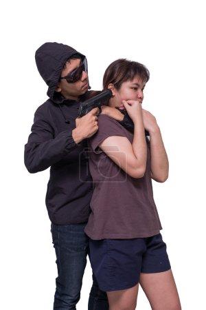 Bandits holding guns, captured the women's teen hostage