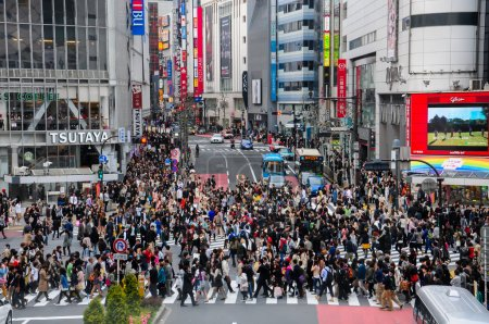 Lot of people crossing crosswalk at Shinjuku