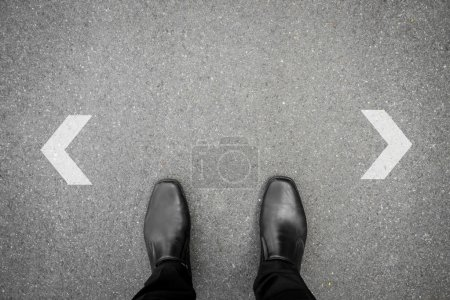 Photo for Black shoes has decision to make at the crossroad - Royalty Free Image