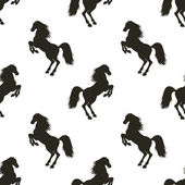 Vector seamless pattern with hand drawn silhouettes rearing horse  In black and white colors
