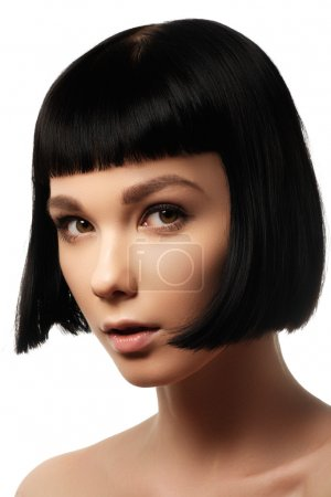 Beauty model with perfect glossy black hair. Close-up portrait. Portrait of a beautiful woman in short brunette bob with neat clean hair. Fashion bob hairstyle