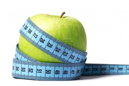 Green apple with blue measuring tape