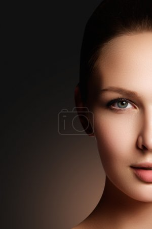 Photo for Make-up & cosmetics. Closeup portrait of beautiful woman model face with clean skin. Natural skincare beauty, clean soft skin. Spa treatment - Royalty Free Image