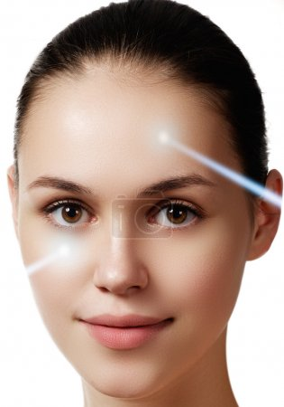 Close-up portrait of pretty woman ready for rejuvenation treatment. Young attractive  female. Laser surgery. Skin care concept