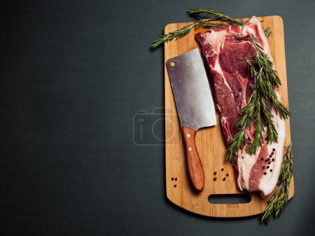 Pork meat on cutting board