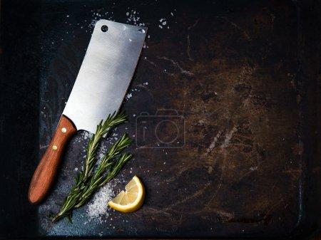 Kitchen axe on grunge background