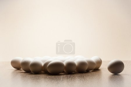 Eggs on wooden table background