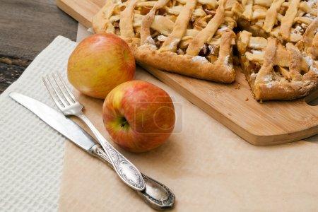 Apple pie on a dark wood background