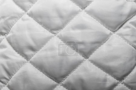 quilted fabric texture of white color for hammering,