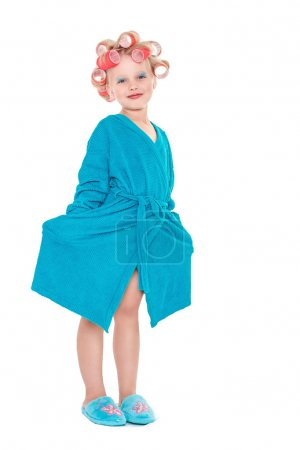 Little girl in blond hair curlers and makeup isolated on white background space for inscriptions