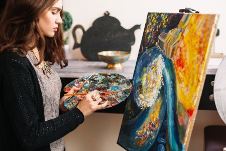 The artist creates colorful abstract painting