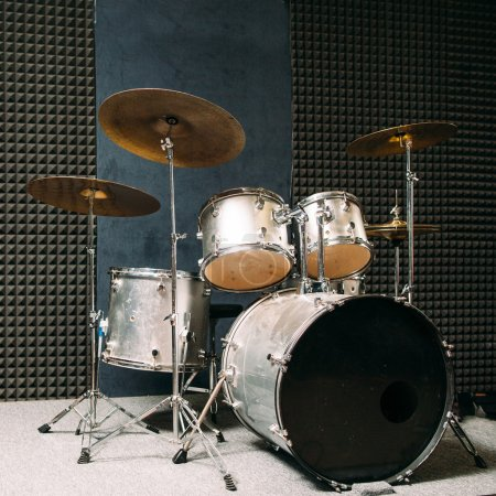 Drum set on stage prepared for playing.
