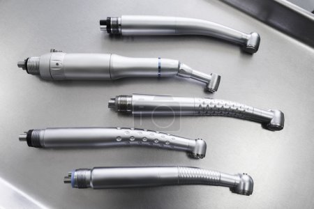Set of dental handpieces without burs flat lay