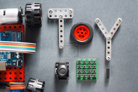 Photo for Educational construction, diy toys for adults and kids. Electronic machine made on microcontroller base for studying and fun. Joyful training tool - Royalty Free Image