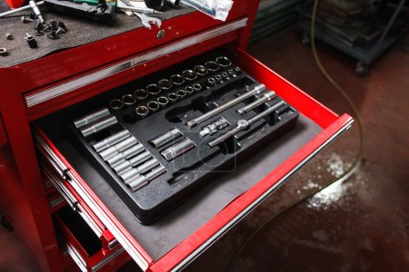 Photo for Kit of repairing tools in workshop. Small garage toolbox, handyman, hobby concept - Royalty Free Image