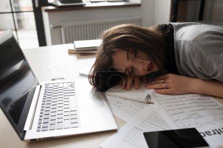 Sleeping worker after late night work, overworking
